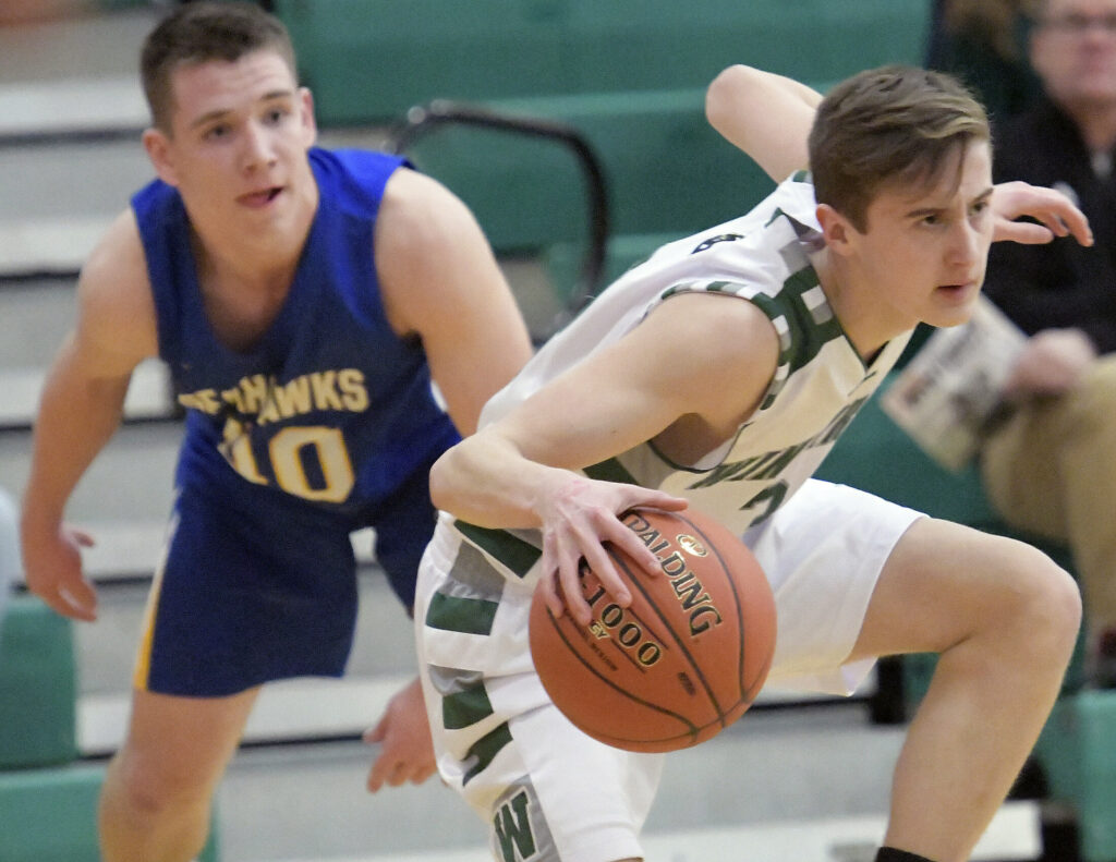 Winthrop's Cam Hachey dribbles past Boothbay's Hunter Crocker during a Mountain Valley Conference game last season in Winthrop.