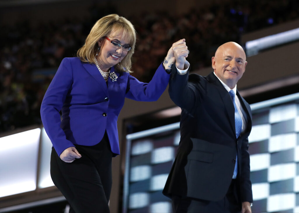 Former Rep. Gabby Giffords, D-Ariz., and her husband Astronaut Mark Kelly (ret.), walk off the stage after speaking during the third day of the Democratic National Convention in Philadelphia, Wednesday, July 27, 2016.
