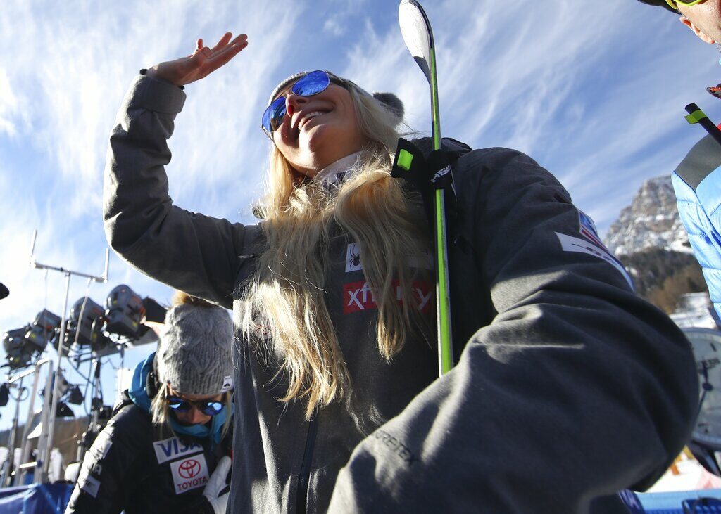 United States' Lindsey Vonn waves as she stands in the finish area after completing an alpine ski, women's World Cup super-G in Cortina D'Ampezzo, Italy, Sunday, Jan. 20, 2019.