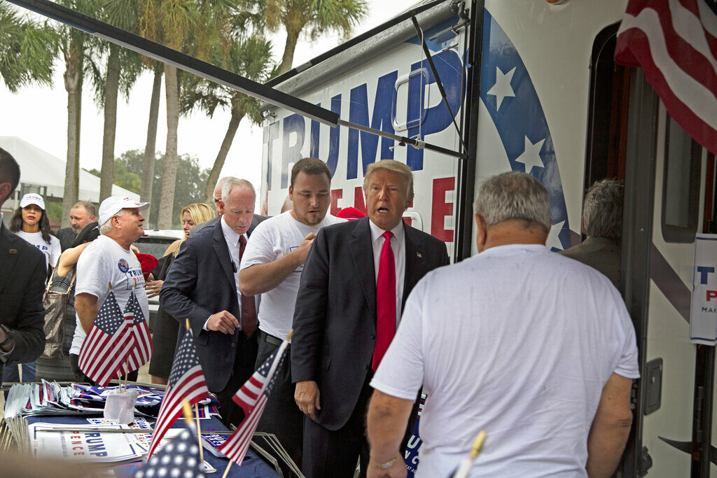 A woman is alleging in a new lawsuit filed Monday, Feb. 25, 2019, that Inside the RV seen here, Trump kissed a member of his campaign staff without consent. The woman, Alva Johnson, can be seen in the background of this photo wearing a Trump shirt and a hat on the left side of the frame.