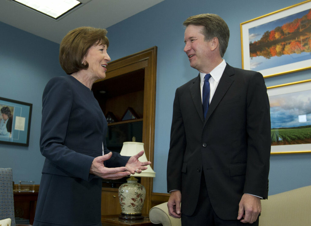 In this file photo, Sen. Susan Collins, R-Maine, meets with Supreme Court Justice nominee Brett Kavanaugh at her office on Capitol Hill before his confirmation last year.