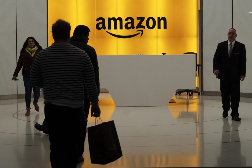 People walk into the lobby for Amazon offices Thursday, Feb. 14, 2019, in New York. Amazon will not build a new headquarters in New York City, a stunning reversal to an ambitious plan that would have brought an estimated 25,000 jobs to the city. (AP Photo/Mark Lennihan)