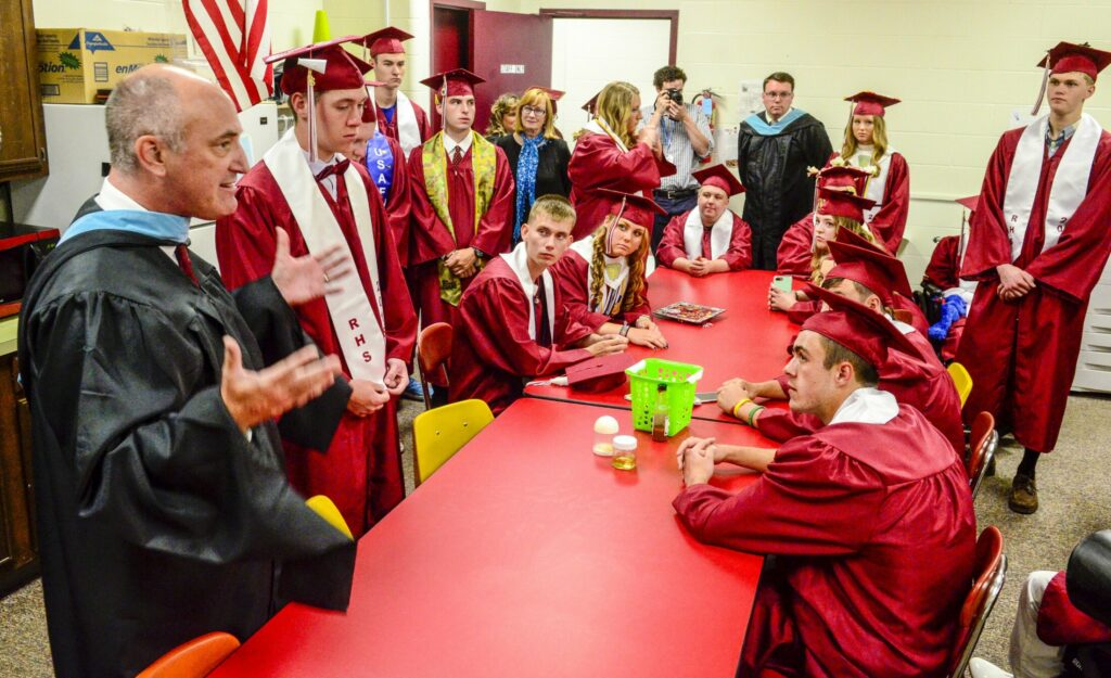 Regional School Unit 2 Superintendent William Zima, left, talks to students on June 9, 2018, before their graduation ceremony at Richmond High School.