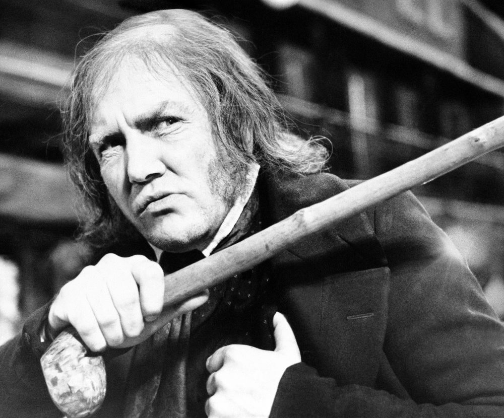 """British actor Albert Finney waves his cane while playing the title role in """"Scrooge,"""" at Shepperton Studios on Jan. 15, 1970."""