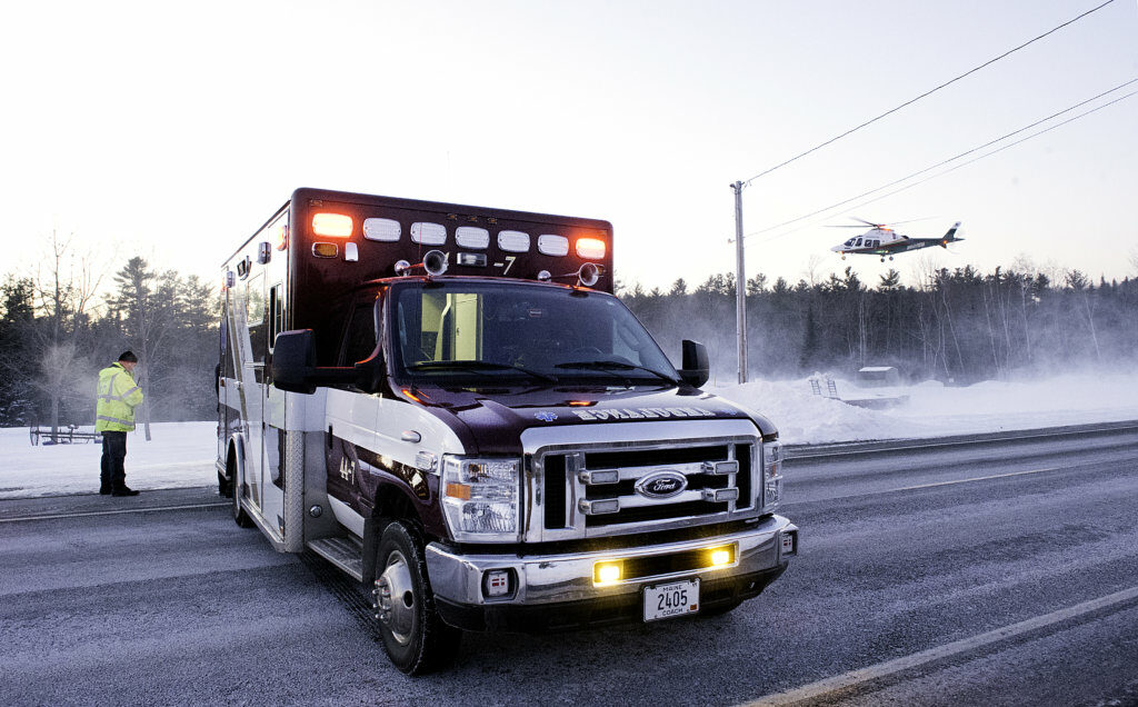 Lifeflight of Maine lifts off from the side of Route 9 as an Lisbon Emergency ambulance blocks traffic in Lisbon on Friday evening.