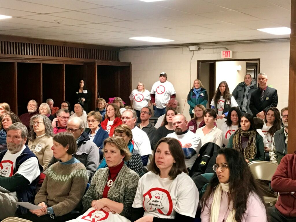 "About 100 people attended a Farmington Board of Selectmen's meeting on Tuesday, Feb. 27, 2019, many of whom wore t-shirts that read, ""NO CMP Corridor"" and voiced opposition to a new transmission line through western Maine proposed by Central Maine Power."