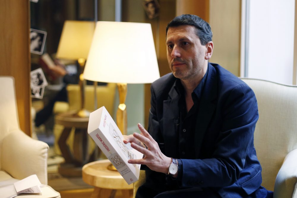 "French writer Frederic Martel gestures during an interview with Associated Press, in Paris, Friday, Feb. 15, 2019. In the explosive book ""In the Closet of the Vatican"" author Frederic Martel describes a gay subculture at the Vatican and calls out the hypocrisy of Catholic bishops and cardinals who in public denounce homosexuality but in private lead double lives."