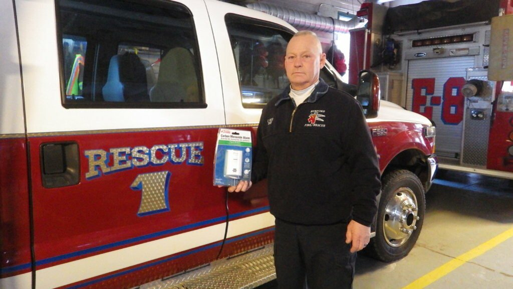 Rumford Fire Chief Chris Reed holds a carbon monoxide detector, which he says people must have to protect themselves from a gas that is colorless, odorless and deadly.