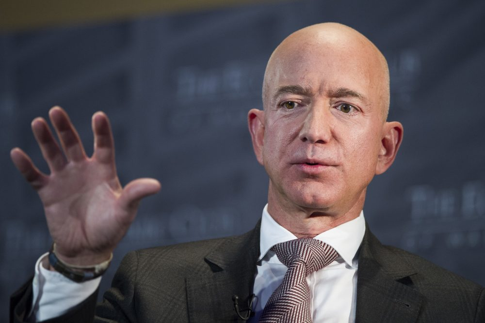 Jeff Bezos, Amazon founder and CEO, speaks at The Economic Club of Washington's Milestone Celebration in Washington on Sept. 13, 2018. Bezos says the National Enquirer is threatening to publish nude photographs of him unless his private investigators back off the tabloid that detailed the billionaire's extramarital affair.