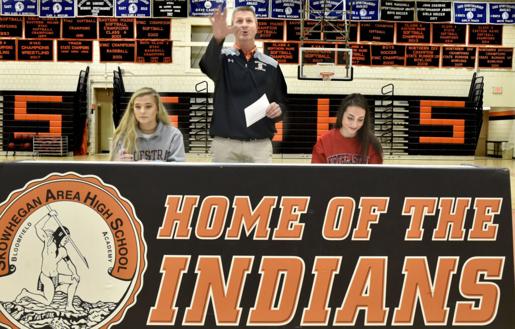 Skowhegan Area High School athletic director Jon Christopher speaks during a ceremony in which field hockey players Lizzie York, left, and Maliea Kelso signed letters of intent on Nov. 18.