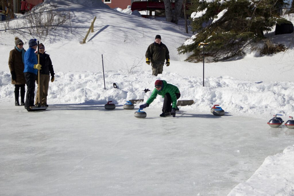 Lucy Simonds shows off her curling skills during the Fourth annual Rangeley Winterpaloozah! on Feb. 17 in Rangeley.