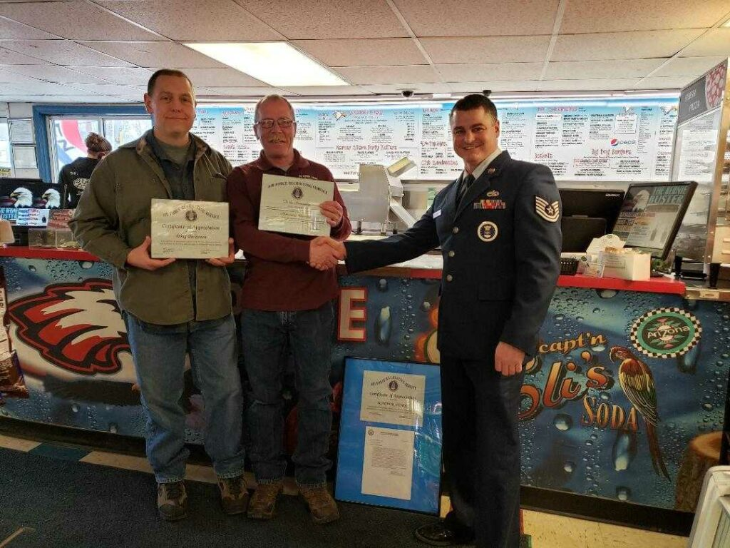 Doug Dickinson, left, and Todd Thibodeau, recently were presented with Honorary Recruiter Certificates from Tech. Sgt. Michael Lujan with the Air Force.