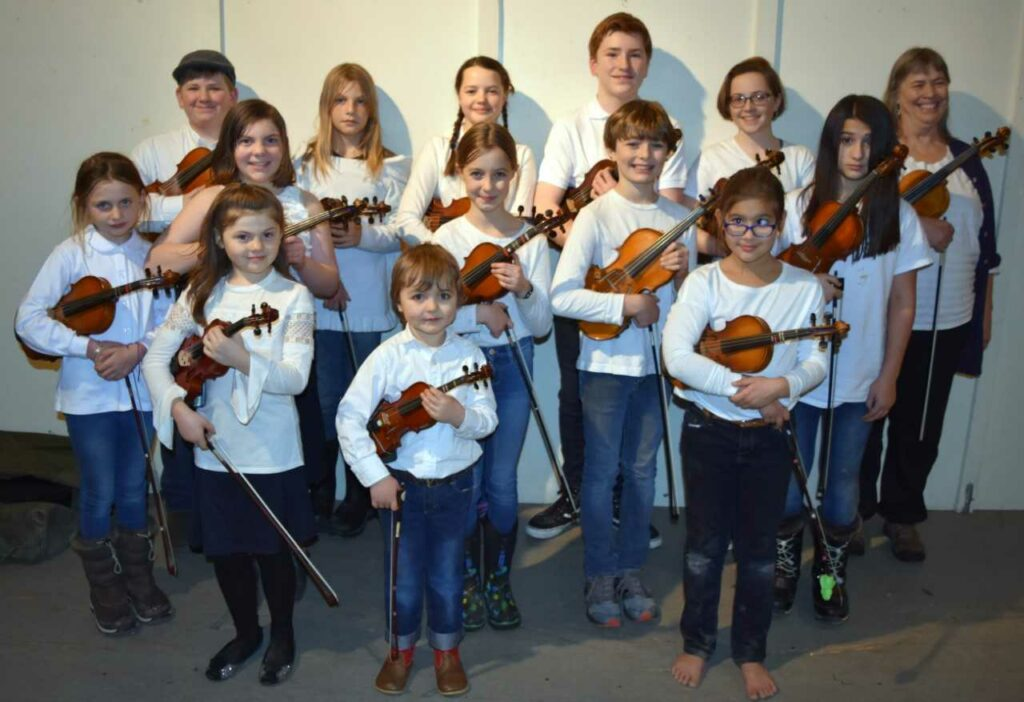Pineland Fiddlers front from left are Mary Philbrick, Silas Edwards and Victoria Hahn. Second row from left are Cora Welling, Allison Philbrick, Nori Edwards, Caleb Edwards and Amelie Hahn. Back from left are Owen Kennedy, Beck Welling, Lily Scease-Drouin, Elijah Huttman, Camila Ciembroniewicz, and Ellen Gawler.