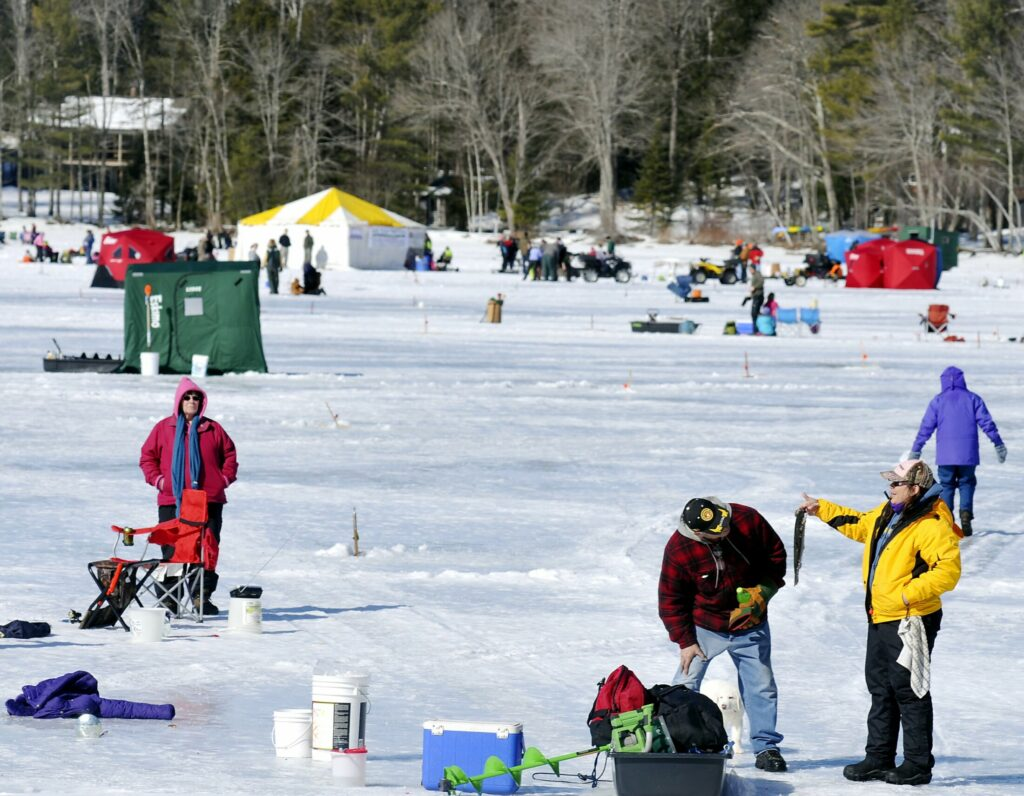 Anglers crowd Cochnewagon Lake in Monmouth during the fourth annual Jack Traps Youth Ice Fishing Derby on Feb. 22, 2013. The ice fishing derby is back for its 10th year on Saturday.