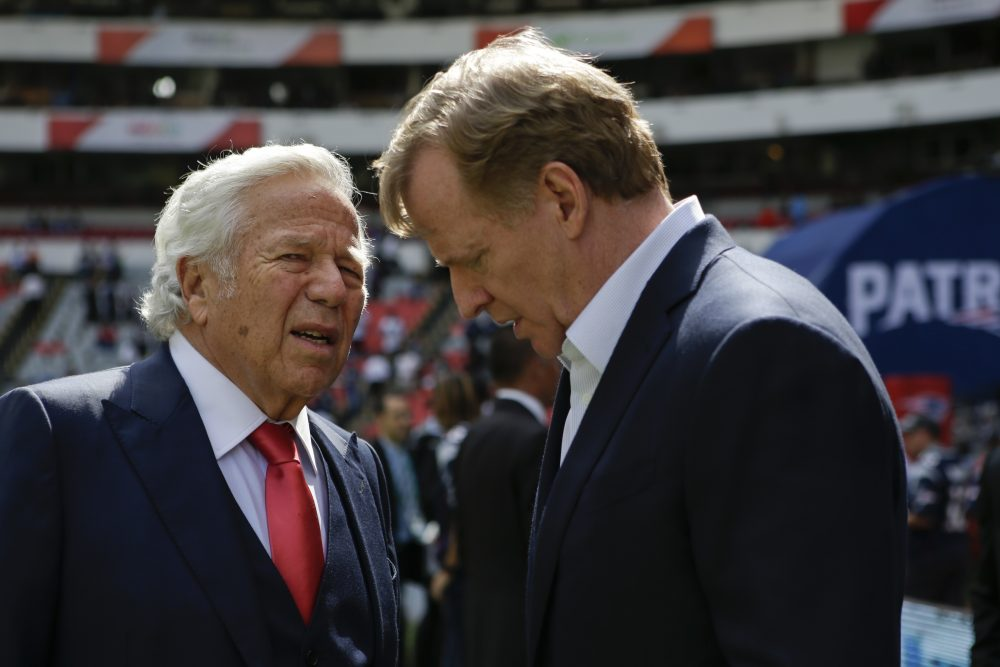 In this Nov. 19, 2017, file photo, NFL Commissioner Roger Goodell, right, talks with New England Patriots owner Robert Kraft before the Patriots face the Oakland Raiders in an NFL football game in Mexico City. Pending the completion of police investigations in Florida, and likely a league probe as well, Goodell could punish Kraft for being charged with two counts of soliciting a prostitute.