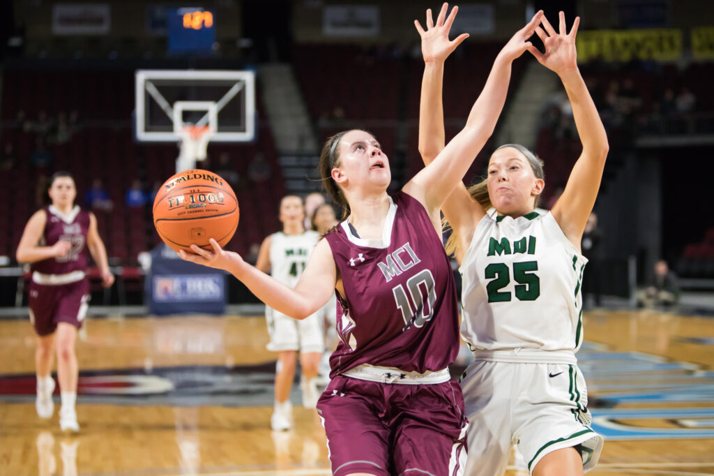 MCI's Sydney Farrar  (10) goes up for a shot as MDI's Georgia Candage defends  during a Class B North quarterfinal game Saturday in Bangor.