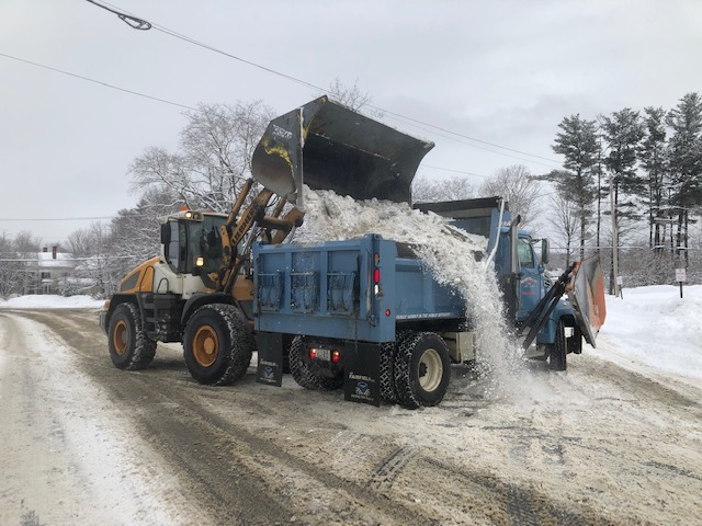 William Marsh uses a front-end loader Thursday to clean ice and snow from Main Street Skowhegan into a waiting Highway Department truck driven by Walter Powell. The loads go to one of three snow dumps in town. Morning Sentinel photo by Doug Harlow.