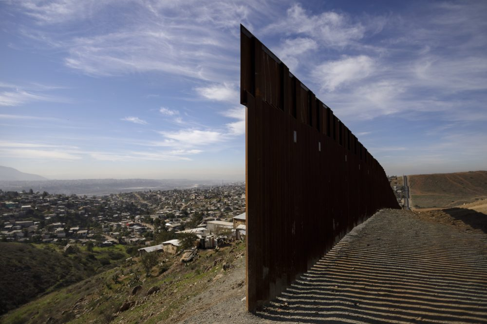 FILE - In this Dec. 22, 2018, file photo, Tijuana, Mexico, left, and San Diego, Calif, right, are seen separated by the U.S. border fence. (AP Photo/Daniel Ochoa de Olza, File)