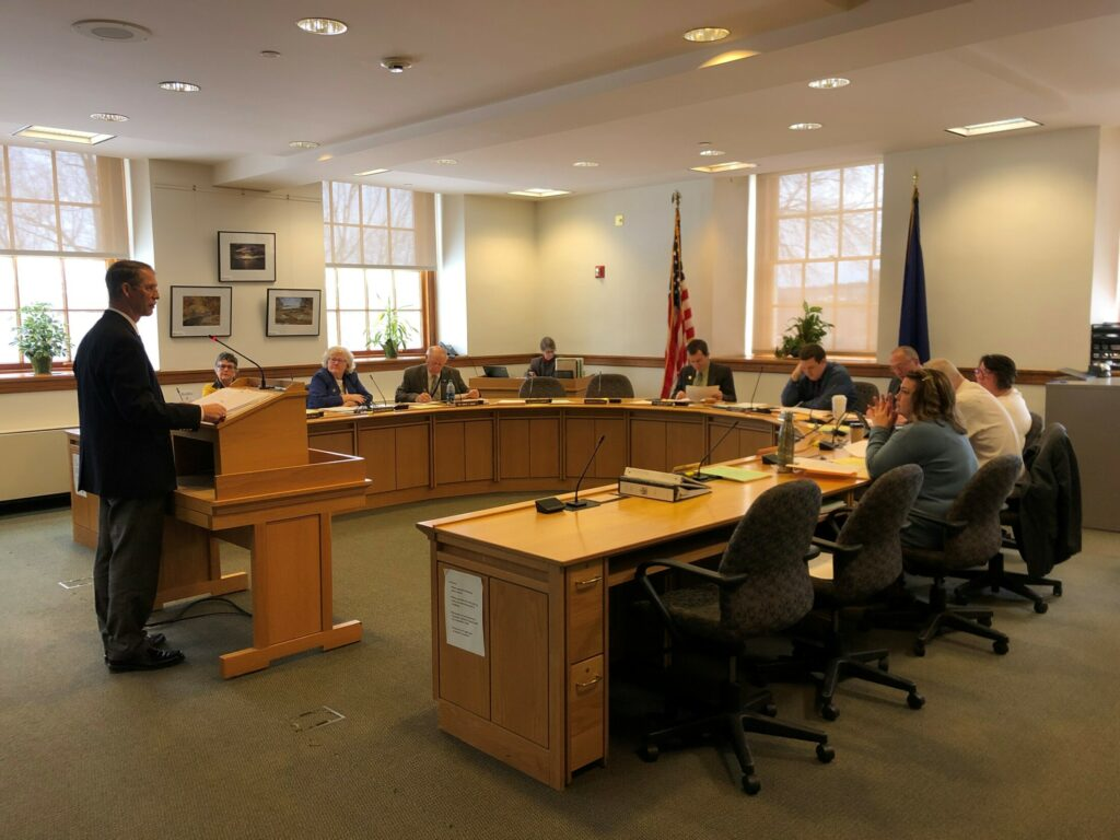 China Town Manager Dennis Heath defends a bill before the Legislature's Taxation Committee on Wednesday that would allow municipalities to opt of assessing certain taxes.