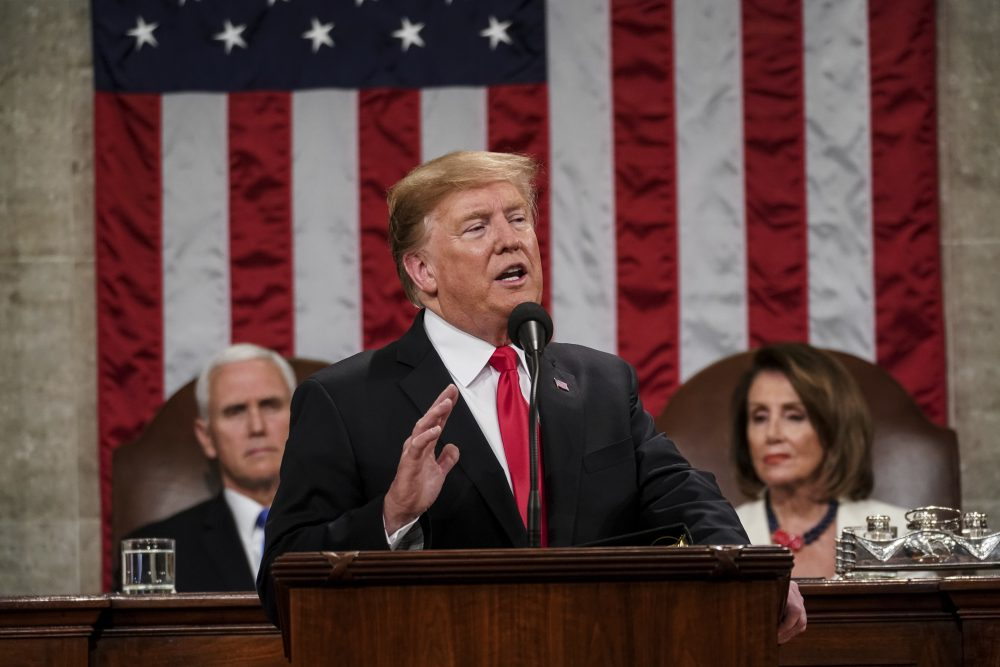 In this Feb. 5, 2019, photo, President Donald Trump gives his State of the Union address to a joint session of Congress at the Capitol in Washington, as Vice President Mike Pence, left, and House Speaker Nancy Pelosi listen. (Doug Mills/The New York Times via AP, Pool)