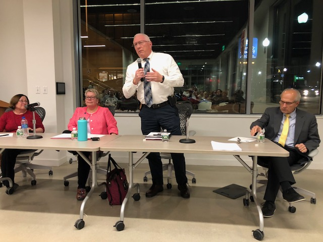 Lisa Hallee, Charlotte Warren, Waterville Police Chief Joseph Massey and Gordon Smith at a forum about the opioid crisis in Waterville on Thursday.
