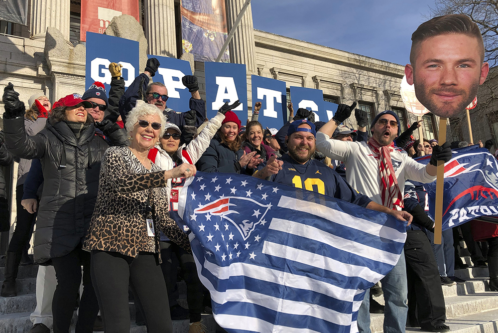 Workers at Boston's Museum of Fine Arts rally outside in New England Patriots garb on Friday. The museum and Los Angeles' J. Paul Getty Museum are trading a little trash talk ahead of the Super Bowl between the Patriots and the Rams.