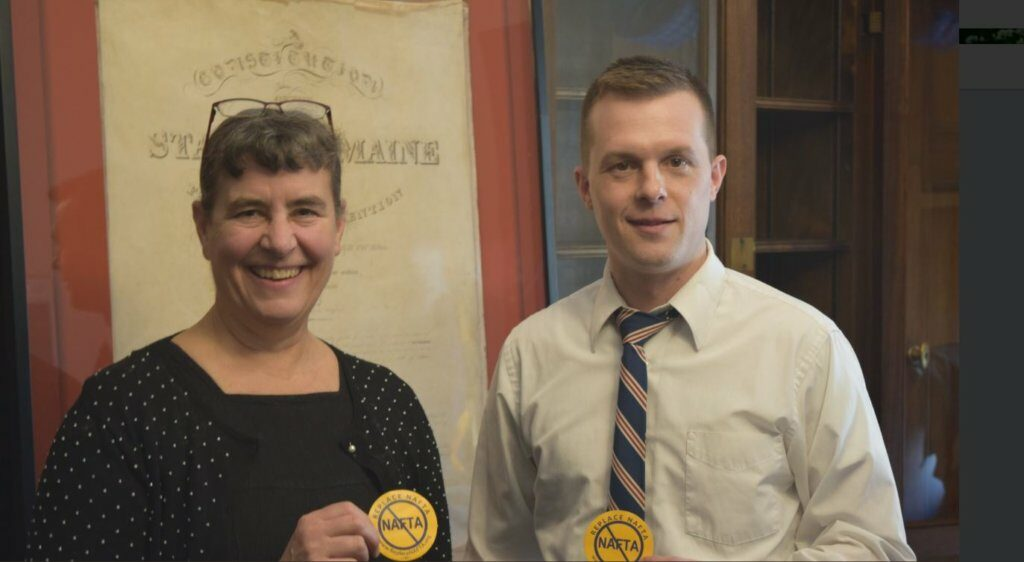 U.S. Rep. Jared Golden, a 2nd District Democrat, posing with Cynthia Phinney, leader of the Maine AFL-CIO, whom he invited to this week's State of the Union speech. They are each holding buttons opposing the North American Free Trade Agreement.