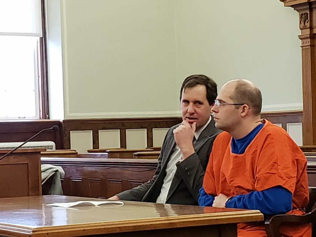Zachary Titus, right, listens to his attorney Jeremy Pratt before the start of a hearing Monday, Feb. 4 in Knox County Superior Court.
