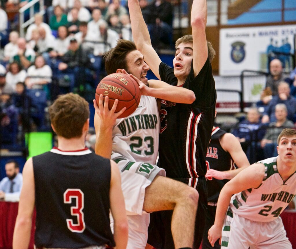 Winthrop's Jared Mclaughlin goes up for a layup against the defense of Hall-Dale Ashtyn Abbott during the Class C South regional final Saturday in Augusta.