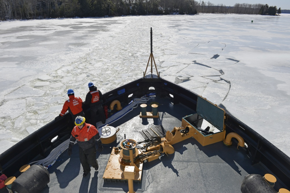 The crew of the Coast Guard Cutter Thunder Bay breaks ice along the Kennebec River in Gardiner in this March 27, 2014 photo.
