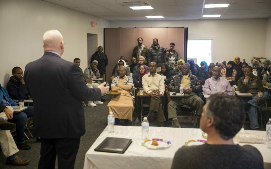 Interim Portland Police Chief Vern Malloch speaks with about 40 people Friday at the Maine Muslim Community Center about the investigation into the shooting death of Isahak Muse. The group asked questions about the case and expressed fears that Muse's killing was a hate crime.