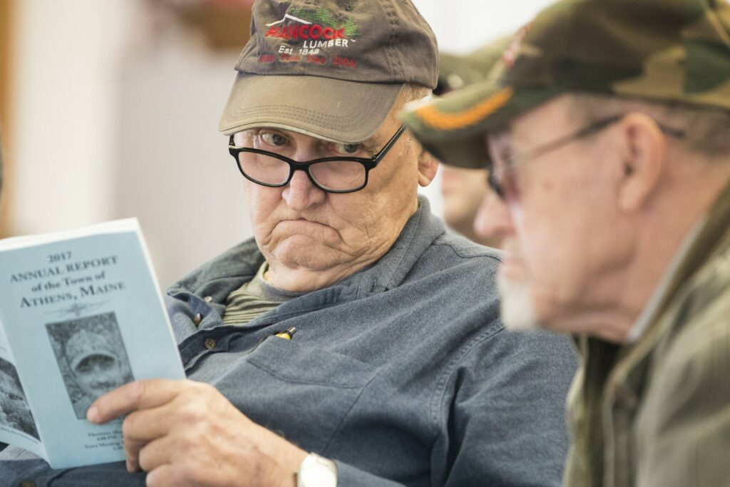 Earlande Lake, left, looks at Erald Corson, as he asks a question March 9, 2018, at last year's Athens Town Meeting at Somerset Academy. The 2019 edition of Town Meeting is set for Saturday, March 9, again, with elections on Friday.
