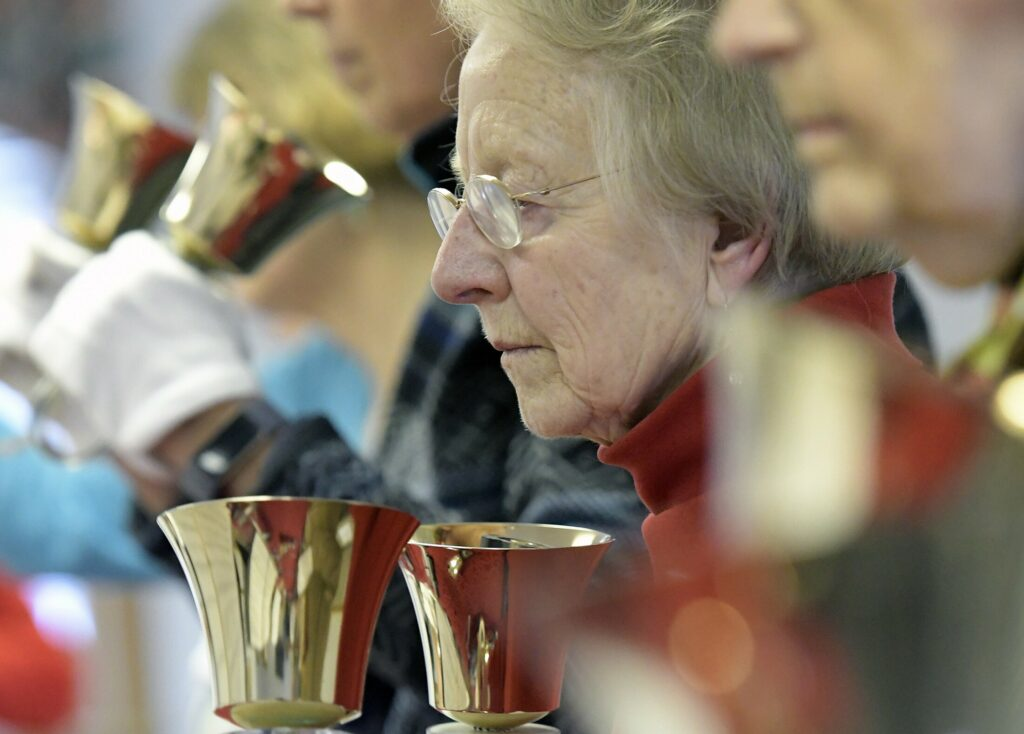 Lee Gilman, 84, rehearses ringing bells with other members of the Winthrop Area Handbell Ringers on Feb. 21 in Winthrop.