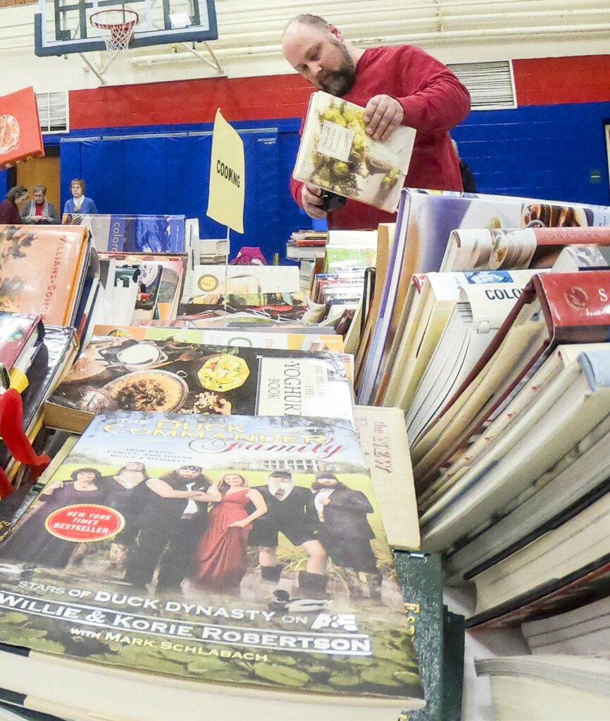 BELGRADE, ME - MARCH 2: Shoppers browse cook book section during Friends of the Belgrade Library book sale on Saturday March 2, 2019 in the Belgrade Central School gym. (Staff photo by Joe Phelan/Staff Photographer)