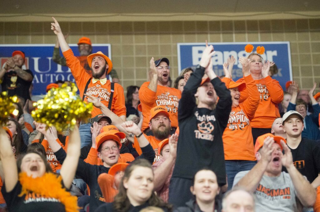 Forest Hills fans decked out in orange school colors fill the stands for the class D state championship game Saturday at the Cross Insurance Center in Bangor.