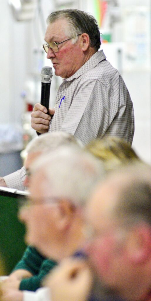 Moderator Bill Lynds runs the Anson Town Meeting on Saturday in the Carrabec High School gymnasium. Voters passed 42 warrant articles in under an hour.