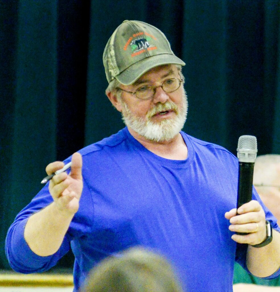 Anson Road Commissioner Arty Lane answers questions during debate Saturday on article about whether to repair a town plow truck. The debate occurred at the Anson Town Meeting, which was held in the Carrabec High School gymnasium.