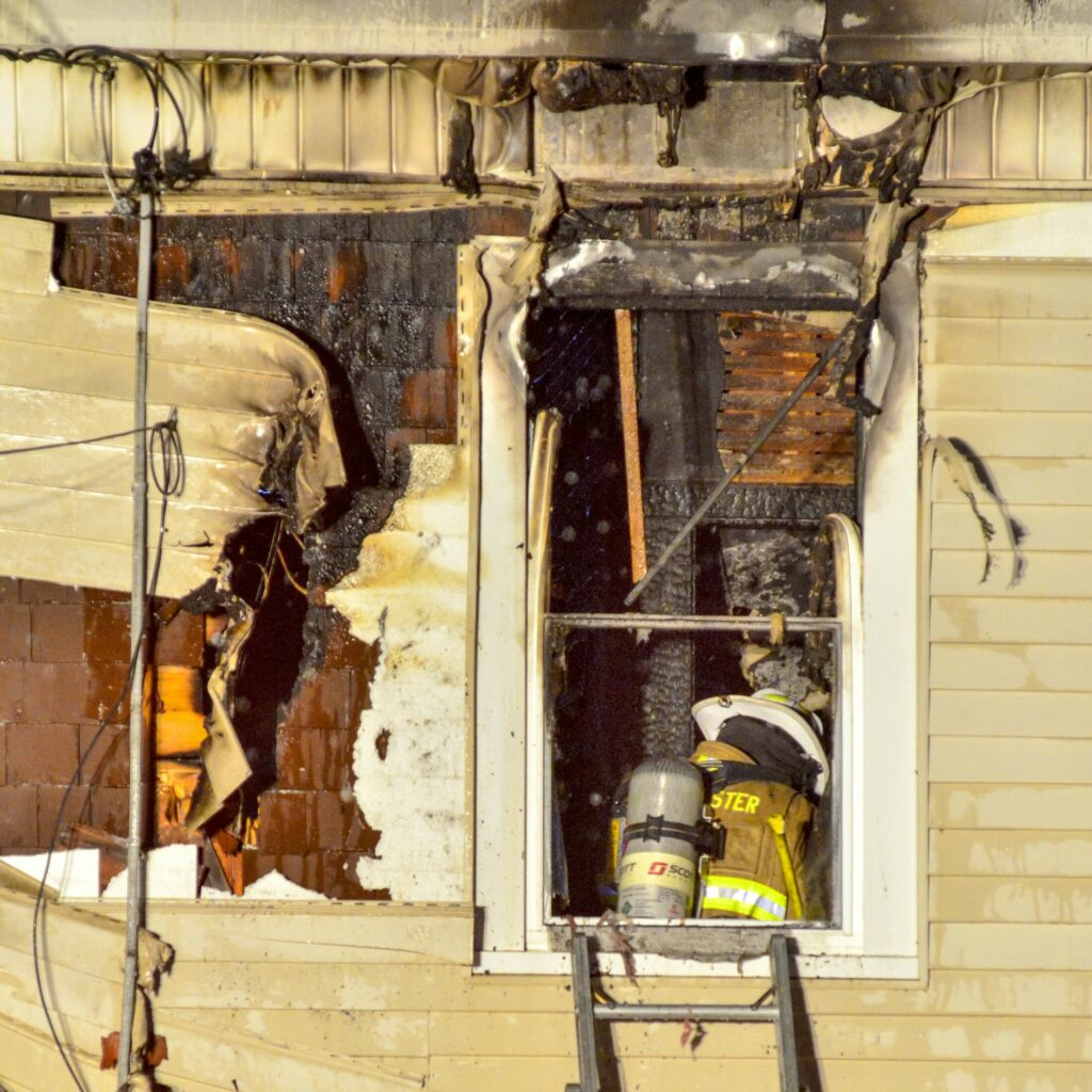 A firefighter inspects damage on the second floor at 6:07 p.m. after putting out a fire at 11 Densmore Court on Saturday in Hallowell. The fire was in a two-story residence at the end of Densmore Court, a short, dead-end street off Wilder Street, near Bolley's Famous Franks. The call came in at 4:24 p.m., and Augusta, Gardiner, Farmingdale and Randolph were some of the departments that responded as mutual aid. Water Street was closed between Winthrop and North streets.