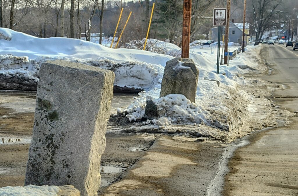 The stone blocks flanking the Lucky Garden restaurant parking lot driveway on March 6 in Hallowell. The state boat launch is seen in the background farther south on Water Street.