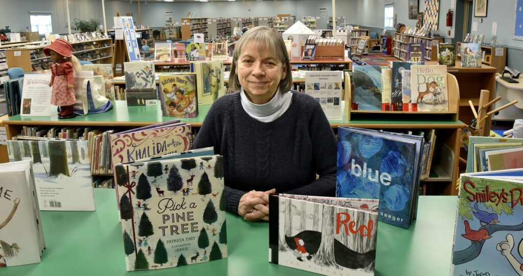 Winslow Public Library Director Pamela Fesq Bonney, on Monday, is looking forward to a new hire arriving next week who will take charge of the children's section, which is the beneficiary of a recent donation.