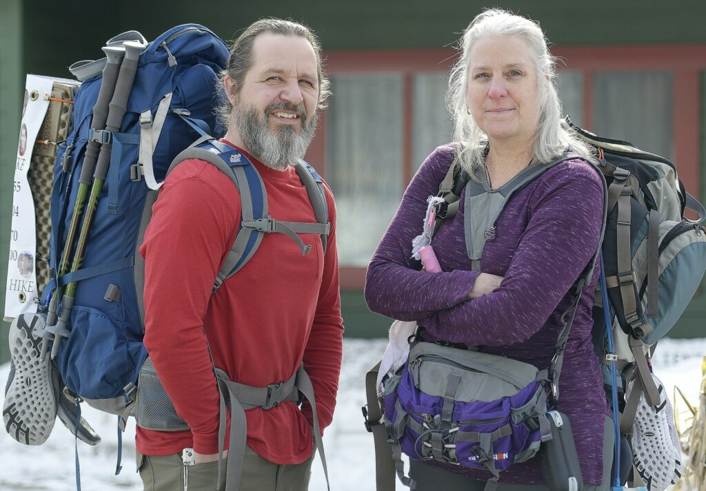 Stephen and Karen Hardy, with their knapsacks adorned with overdose victims, at their Belgrade home on Wednesday. The couple plan to hike a portion of the Appalachian Trail to raise drug overdose awareness and honor victims.