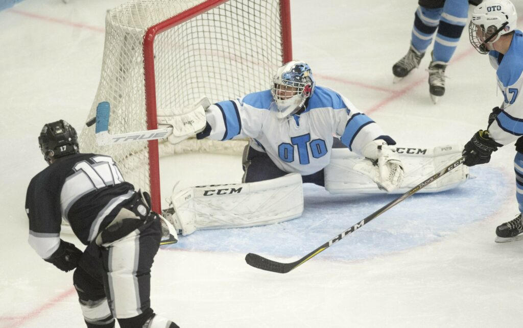Old Town/Orono goalie Kohle Parker makes a stick save on a shot from Kennebec's Cooper Hart (17) in the third period in the Class B North final Wednesday at the Alfond Arena at the University of Maine in Orono.