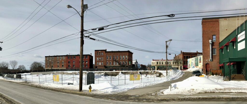 The site of Colby College's planned hotel and restaurant in downtown Waterville is seen Thursday morning.