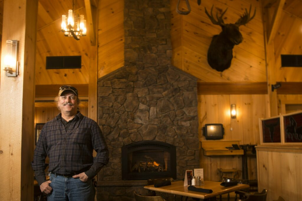 Kevin Joseph stands in the dinning room of his restaurant, Joseph's Fireside Steakhouse, on West River Road in Waterville on Friday. Joseph and co-owner E.J. Fabian have put the restaurant up for sale for $995,000.