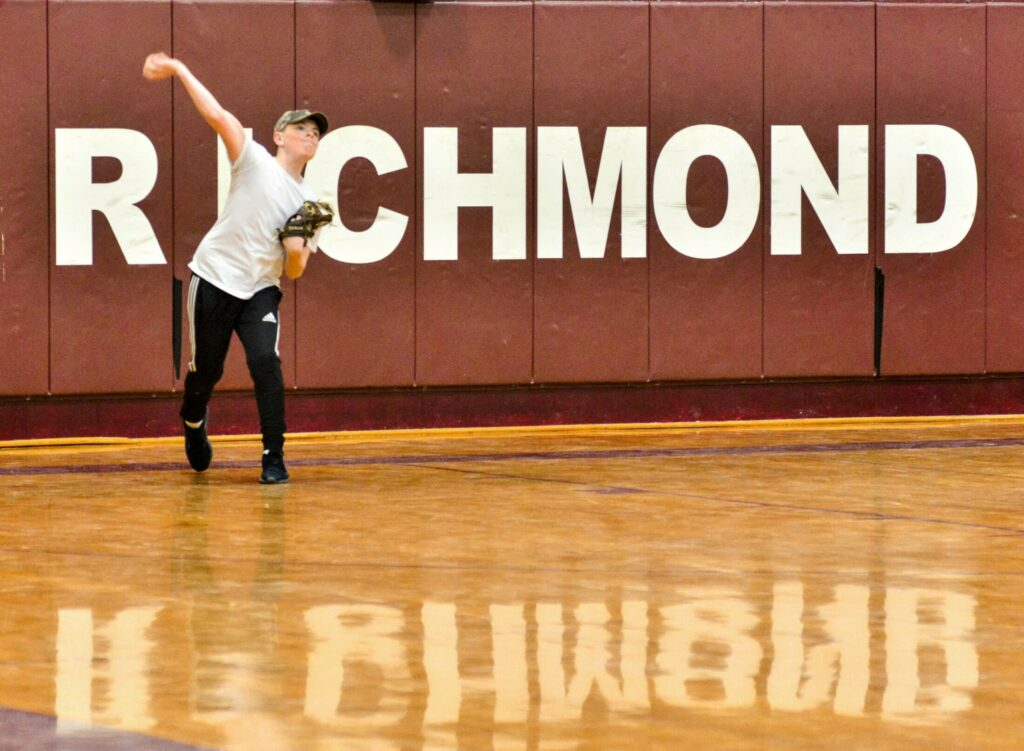Cole Alexander throws long toss on Wednesday at Richmond High School.
