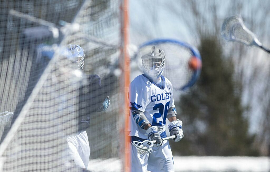 Colby College's CJ Hassan takes a shot on Connecticut College goalie Colin Smith on Saturday at Colby College.