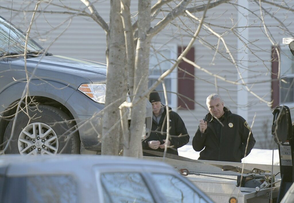 On March 20, Gardiner police Chief James Toman, right, and Sgt. Todd Pilsbury hoist the pickup in which Kenneth Bryant shot himself a day earlier at 16 Fairview St. in Gardiner. Police and fire investigators concluded this week that Bryant shot his estranged wife, Autumn Bryant, in the garage of the residence, drove to Sindey and set her mother's house on fire, then returned to the Gardiner house and killed himself. The pickup was taken to the state police crime laboratory for further examination, police said.
