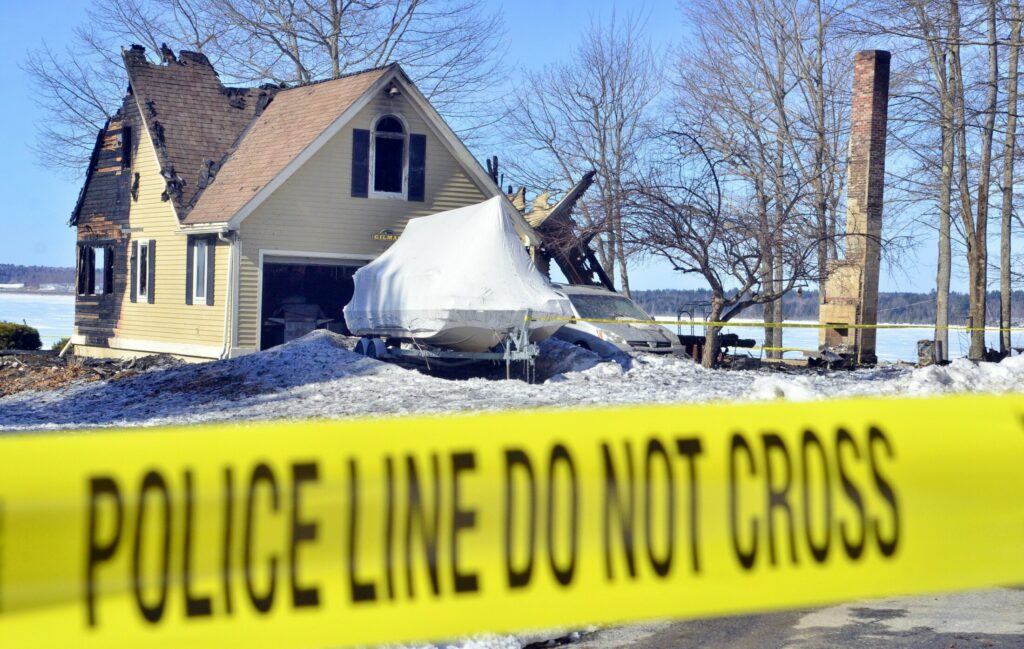 This photo, taken Wednesday, shows the fire ravaged house at 74 Poppy Lane in Sidney.
