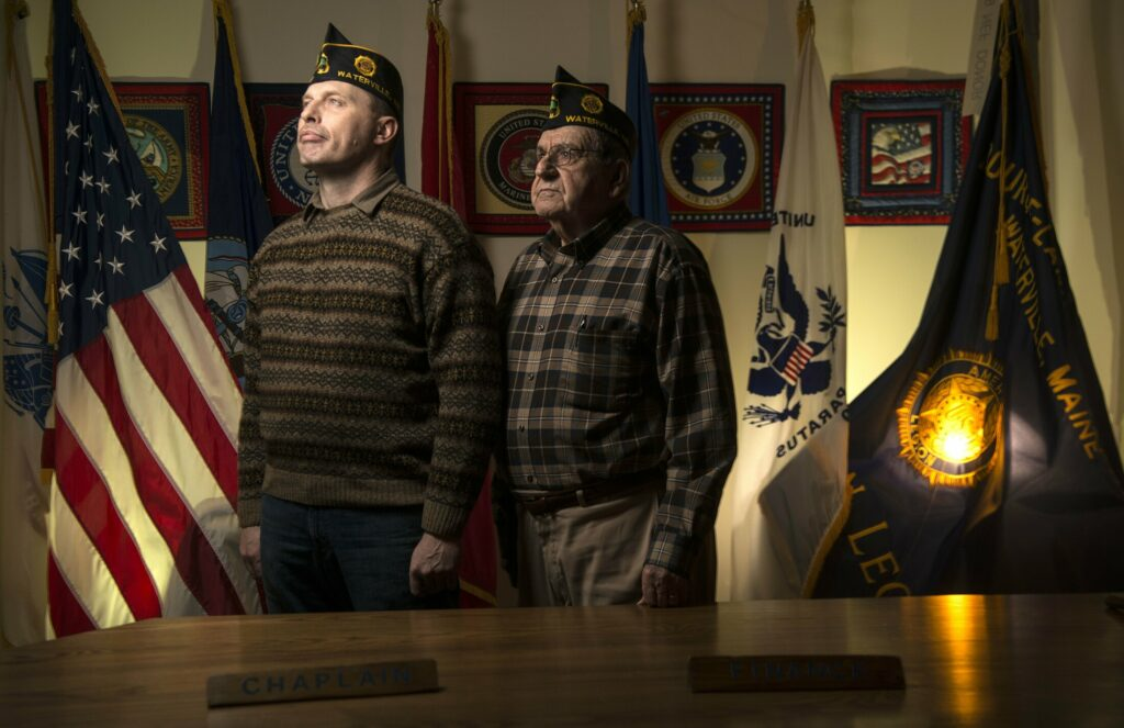 Craig Bailey, commander of Bourque-Lanigan American Legion Post 5, left, and Pearley Lachance, Legion chaplain, pose Friday at the Legion post on Drummond Avenue in Waterville. The post is holding a fundraiser Sunday featuring an Elvis Presley tribute performer.