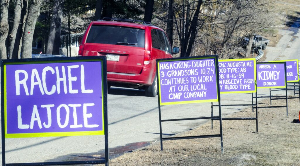 A series of signs seeking a kidney donation for Rachel Lajoie faces drivers Tuesday on South Belfast Avenue (Route 105) in Augusta.